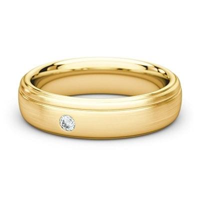Svadobná obrúčka zo žltého zlata s jedným diamantom