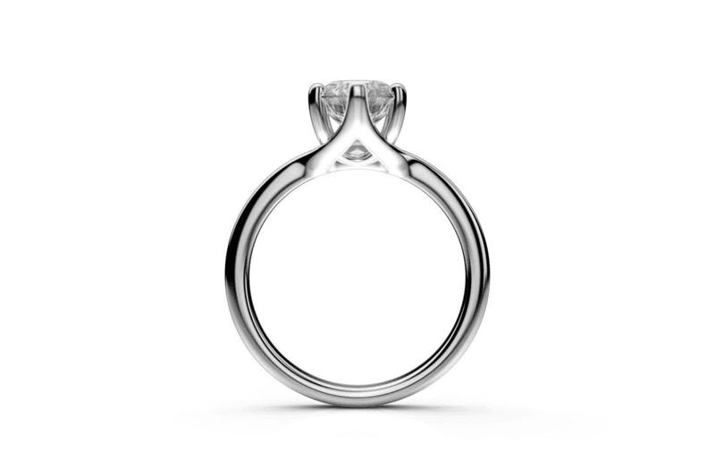 prsten z bieleho zlata s jedným diamantom